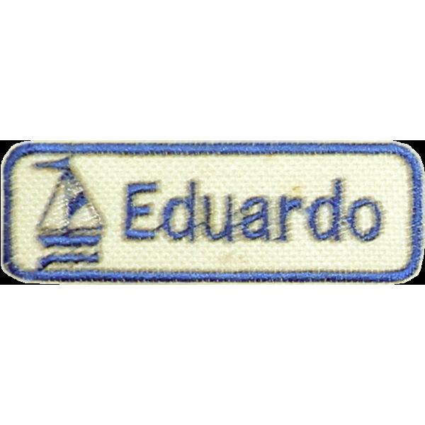Bordado com desenho de um Barco na cor Azul Marinho